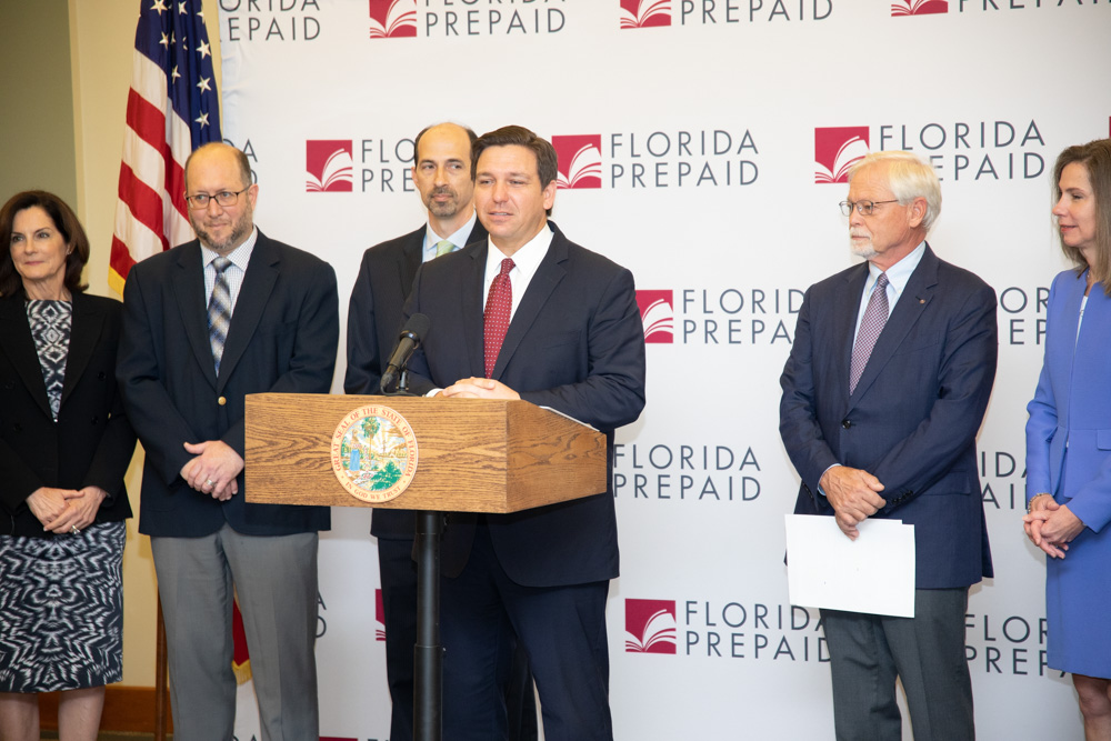 Board Members Adria D. Starkey, Chris Kinsley, Executive Director Kevin Thompson, Governor Ron DeSantis, Board Chairman John D. Rood and Chancellor Kathy Hebda